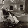 Masked woman in a wheelchair, Pa. - 1970