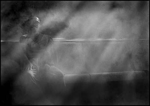 Monk in outdoor smoke - Image by Marko